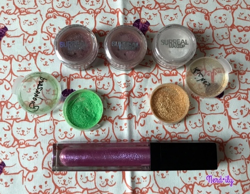 5 eyeshadow shades and a tube of lip gloss from Surreal Makeup