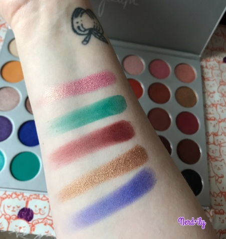 Inner forearm with 5 different eyeshadow swatches from the Jaclyn Hill x Morphe Palette