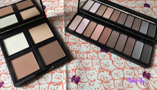 Two makeup palettes by e.l.f. Cosmetics, with one containing eyeshadows and the other containing contour powders.