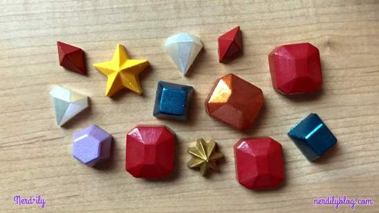 Multiple gems and stars in various colors made out of hot glue.