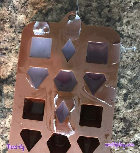 Drying hot glue in gem mold.