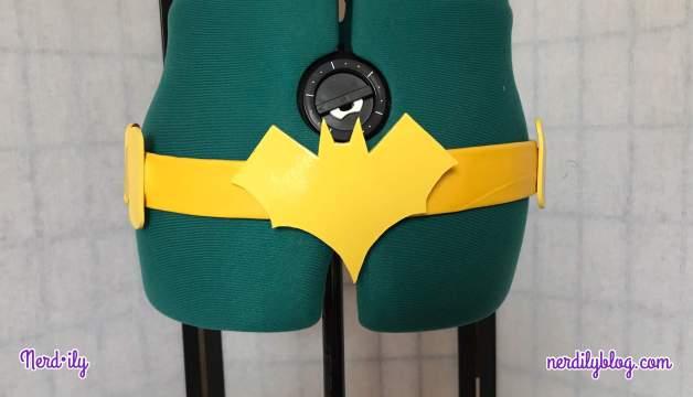 Handmade Batgirl utility belt displayed on dressform.