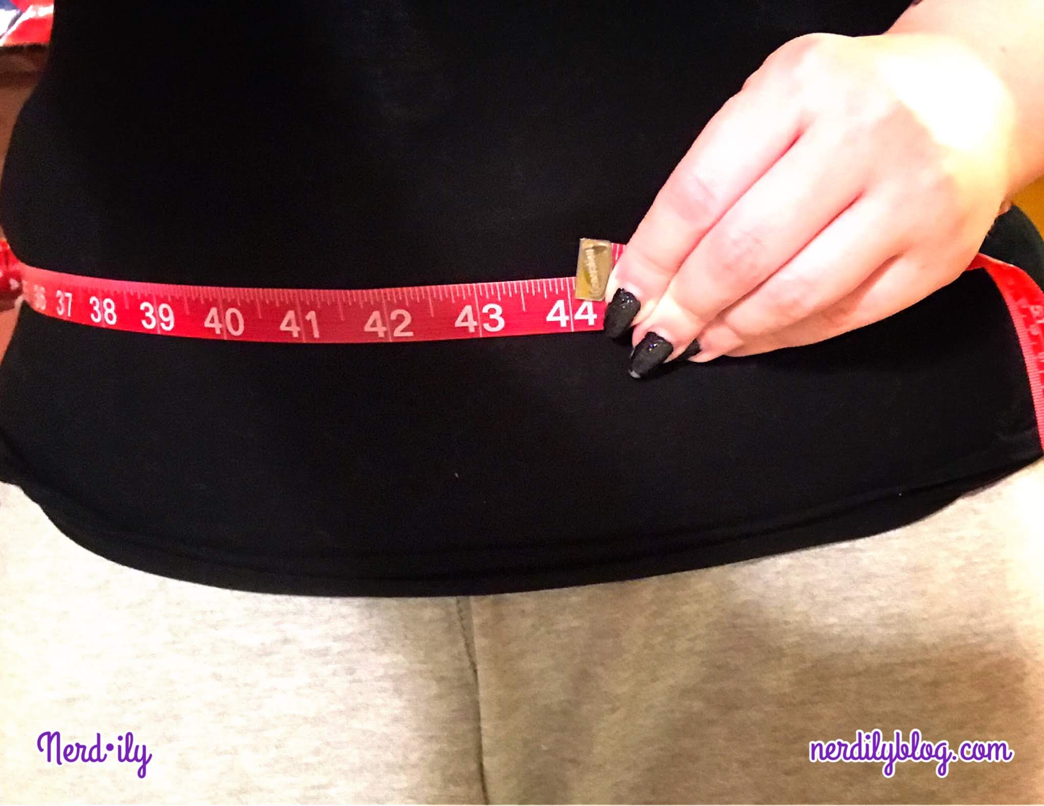 Measuring tape around lower waist of body.