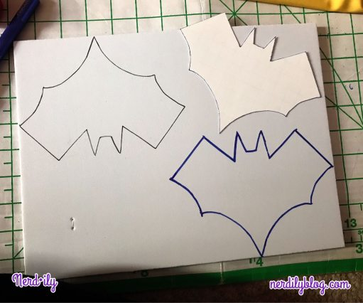Thick piece of craft foam with the Batgirl symbol drawn twice on the surface.