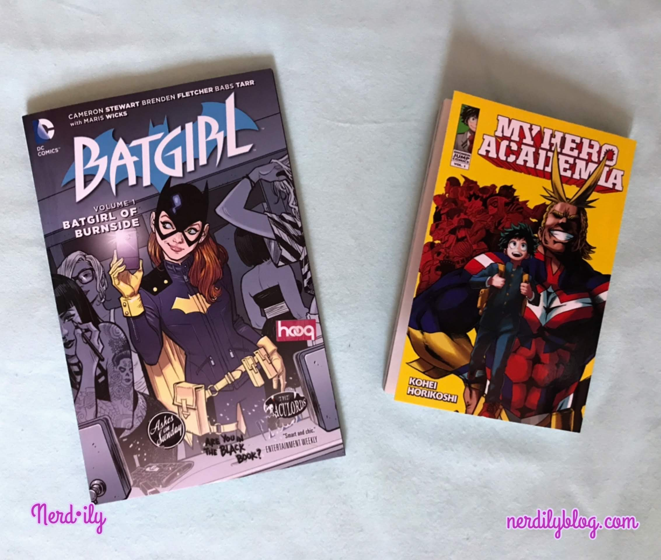 Batgirl of Burnside trade and My Hero Academia Volume 1 side-by-side.
