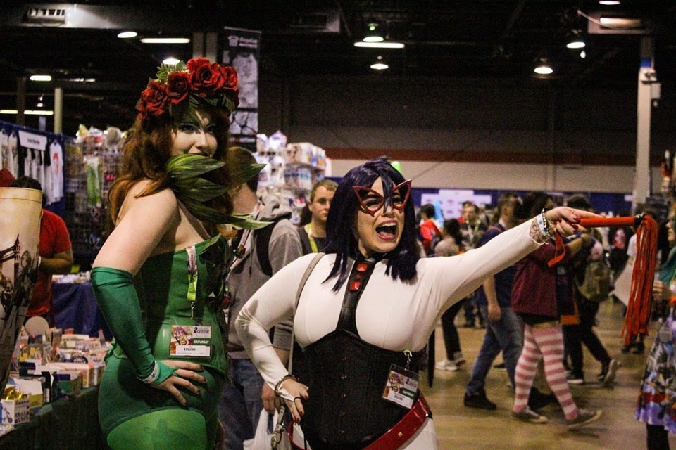 Full Midnight cosplay at ACEN standing next to Poison Ivy.
